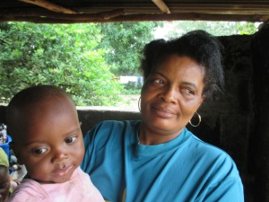 "My aunt Josephine with my infant brother Sinava, meaning ""for tomorrow"" in Mende"