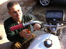 One of the many patch jobs my bike has received. This one is from my Chuar Chra neighborhood mechanic, Dilzin, helping me attach my new clutch.