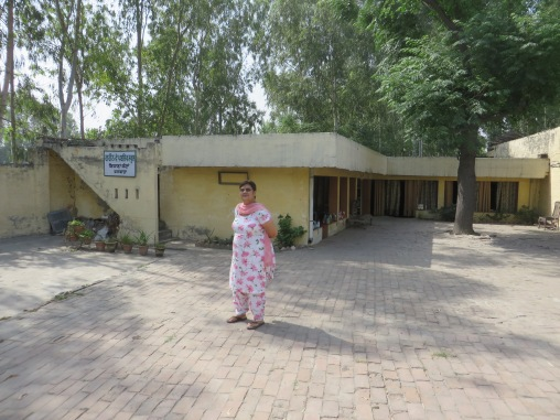 Punam in front of her Greenway Public Kindergarten