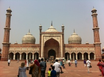 The front facade of the Jama Masjid, standing in the elevated courtyard used for prayer