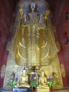 One of the four giant, golden Buddhas of Ananda Temple