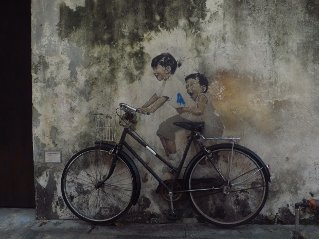 """Lithuanian artist Ernest Zacaharevic was the first commissioned artist to start Penang's wave of street art. His creation """"kids on a bicycle"""" is still the most famous of Penang's street art installations."""