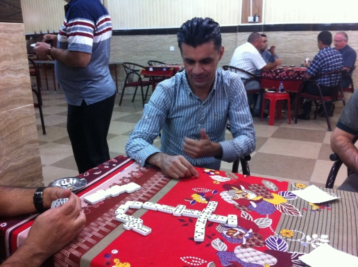 Hindarin showing Peter and I how to play dominoes