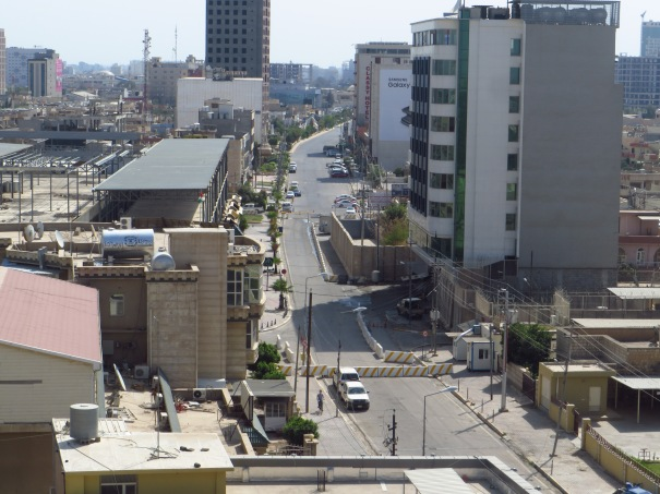 Looking down on Ankawa Boulevard. Cars are no longer allowed, and traffic, any type at all, is almost non existent. The car bomb exploded where the large wall now stands in the middle of the photo