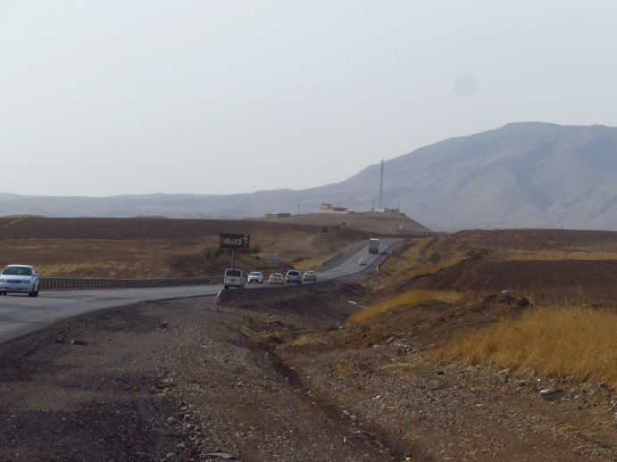 The rolling hills between Erbil and Duhok. Mosul lies about ten miles behind the mountain pictured