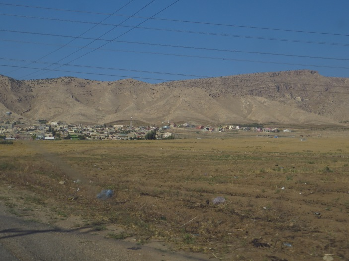 The town of Alqosh lying on the slopes of a small mountain. The monastery of Rabban Hermizd lies tucked away into the rocky mountain on the right side of the photo