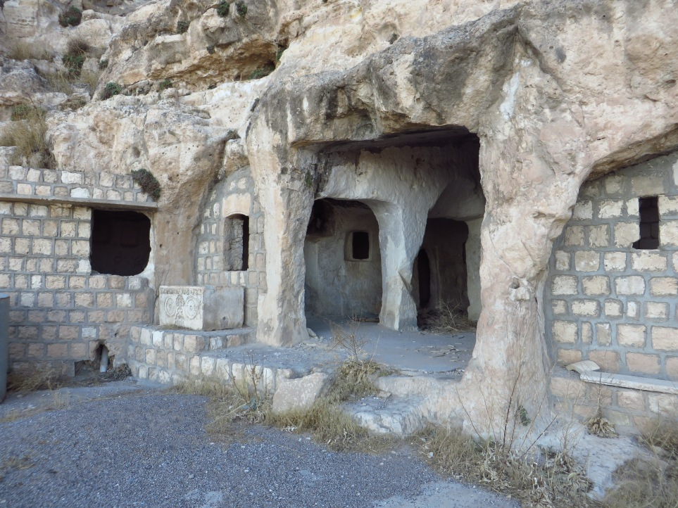 Houses and shelters carved into the rocky hillside