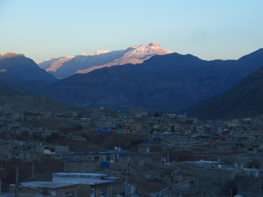 Once the sunlight faded I rode back into Soran. Here passing through a small neighborhood on the edge of Soran, looking through a gap in the mountains to a different angle of Welati-Ciya.